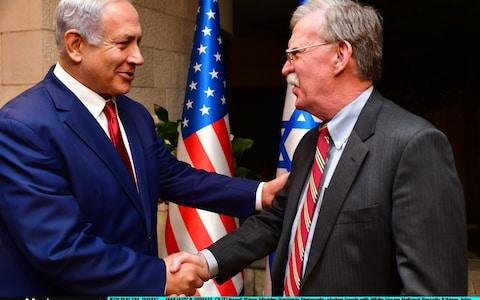 Israeli Prime Minister Benjamin Netanyahu shakes hands with White House National Security Adviser John Bolton as they meet on January 6, 2019 in Jerusalem, Israel. - Credit: Getty Images Europe