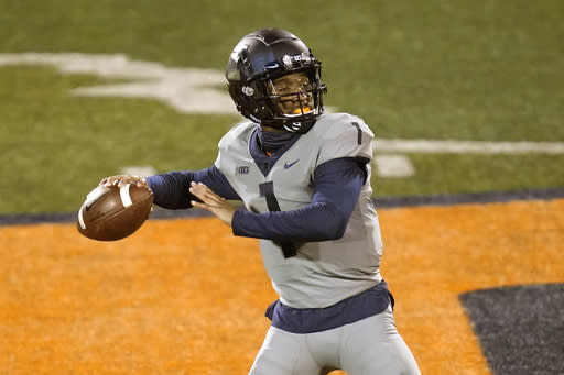 Illinois quarterback Isaiah Williams drops back to pass during the second half of an NCAA college football game against Iowa, Saturday, Dec. 5, 2020, in Champaign , Ill. (AP Photo/Charles Rex Arbogast)