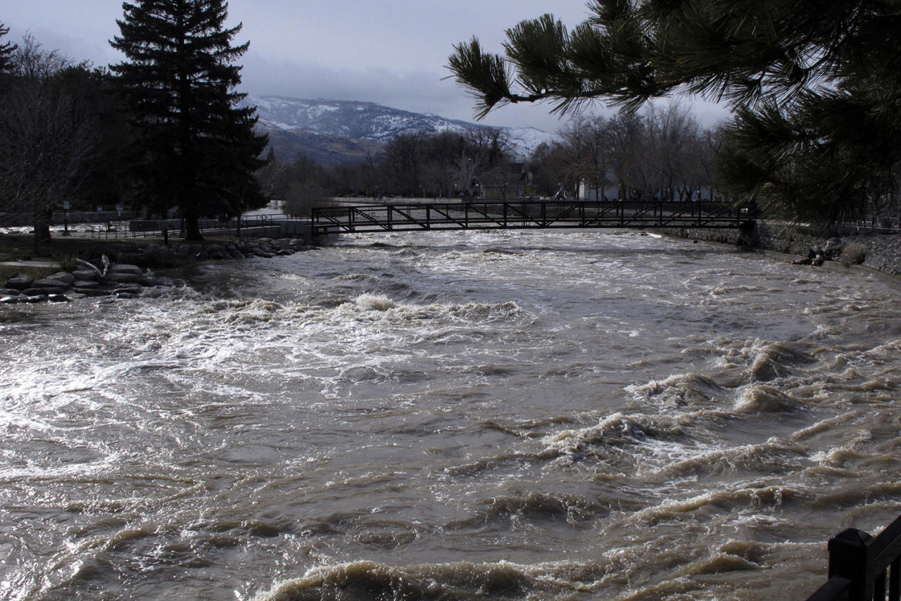 <p>The Truckee River surges through downtown Reno, Nev., Monday, Jan. 9, 2017, after floodwaters crested earlier in the day. Most bridges that had closed were reopened. (AP Photo/Scott Sonner). </p>