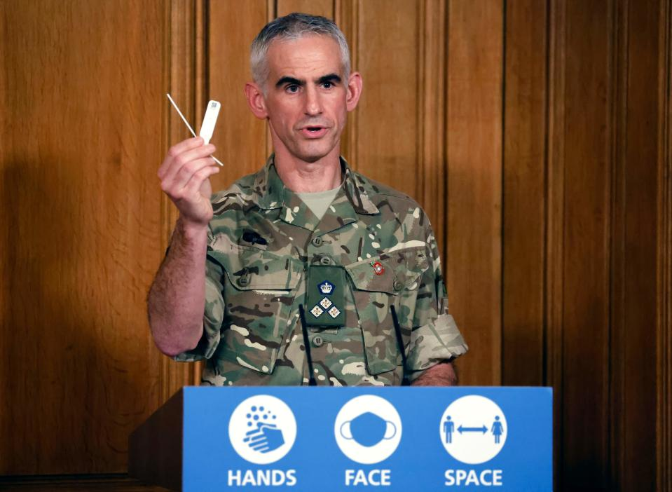 British Army Brigadier Joe Fossey, who is coordinating the mass coronavirus testing pilot in Liverpool, holds up the components of a lateral flow Covid-19 test as he speaks during a virtual press conference on the coronavirus pandemic in the UK inside 10 Downing Street in central London on November 9, 2020. (Photo by Tolga Akmen / POOL / AFP) (Photo by TOLGA AKMEN/POOL/AFP via Getty Images)