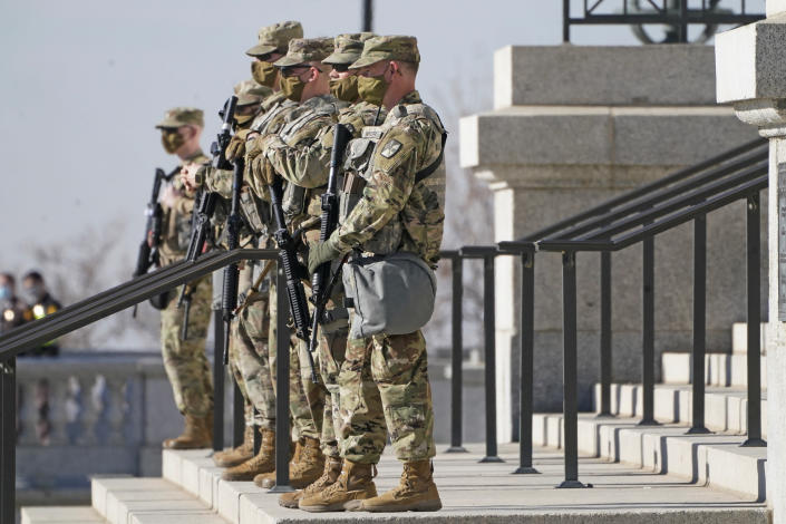 Utah National Guardsmen are shown at the Utah State Capitol Sunday, Jan. 17, 2021, in Salt Lake City. The FBI has warned of the potential for armed protests at the nation's Capitol and all 50 state capitol buildings beginning this weekend. (AP Photo/Rick Bowmer)