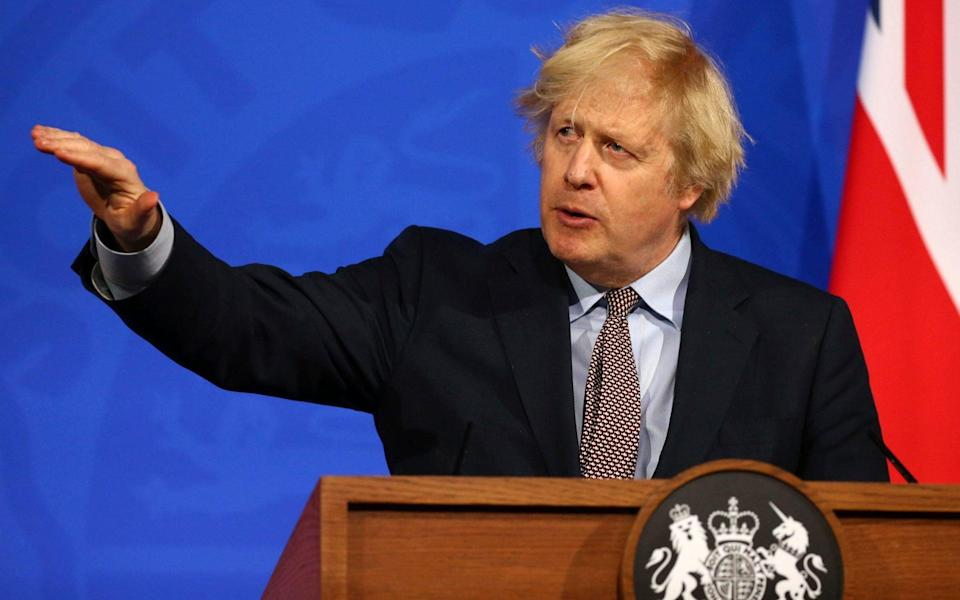 Boris Johnson is expected to signal that, when foreign travel is opened up, restrictions will be based on a traffic light system - Hollie Adams/AFP Pool