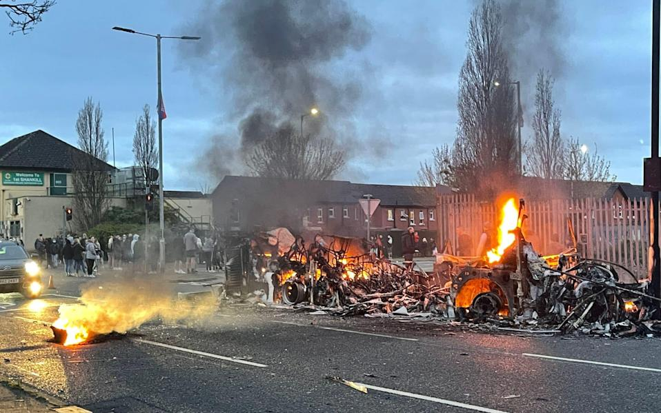 The wreckage of the burnt bus on Shankill Road - PA