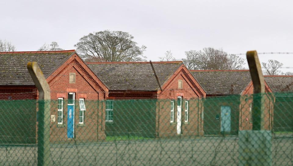 Police said five people were arrested on suspicion of 'racially-aggravated' public order offences outside the former military camp in Folkestone (PA)