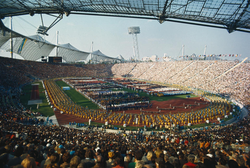 Parade in Olympic Stadium as crowds watch on