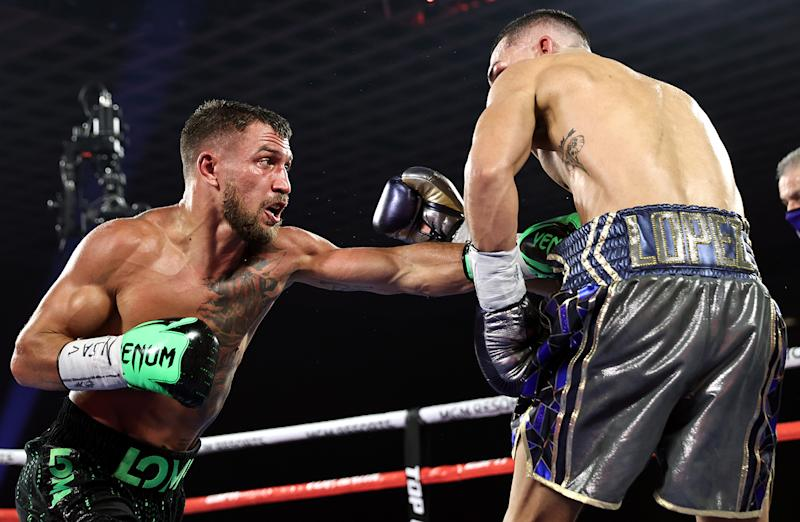 LAS VEGAS, NEVADA - OCTOBER 17: In this handout image provided by Top Rank, Vasiliy Lomachenko punches Teofimo Lopez Jr in their Lightweight World Title bout at MGM Grand Las Vegas Conference Center on October 17, 2020 in Las Vegas, Nevada. (Photo by Mikey Williams/Top Rank via Getty Images)