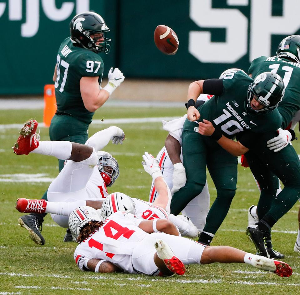 Michigan State Spartans quarterback Payton Thorne (10) fumbles the ball during the second quarter vs. the Ohio State Buckeyes on Saturday, Dec. 5, 2020 at Spartan Stadium in East Lansing, Michigan.