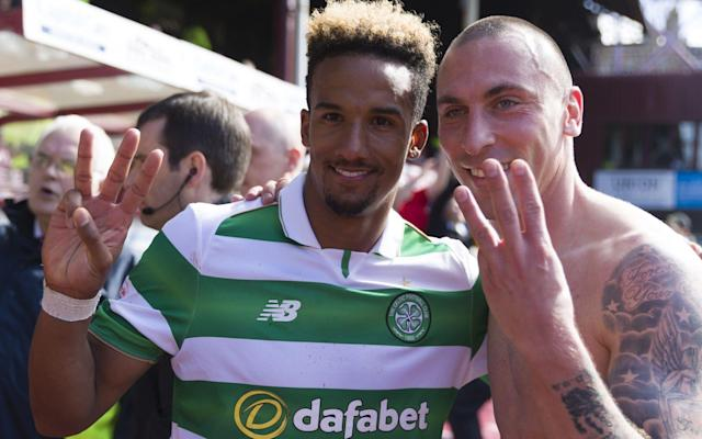 Hat-trick hero Scott Sinclair and Scott Brown hold up three fingers each to signify winning six league titles in a row - Rex Features