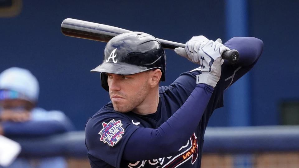 Atlanta Braves first baseman Freddie Freeman (5) bats during a spring training baseball game against the Tampa Bay Rays Sunday, March 21, 2021, in Port Charlotte, Fla. (AP Photo/John Bazemore)