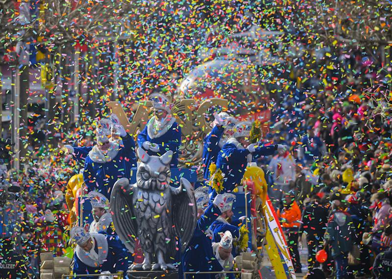 The wagon of the carnival association 'Eule' (lit. owl) drives through the confetti rain during the Rosenmontag (Shrove Monday) carnival procession in Mainz, Germany, 12 Febraury 2018. The 'Rosenmontagsumzug' (Carnival Monday procession) is the highlight of the Mainz carnival and runs under the motto 'So wie der Mond die Nacht erhellt, strahlt Mainzer Fastnacht in die Welt' (lit. like the moon brightens the night, Mainz' carnival radiates during the night) this year. About 8.000 carnival-goers with more than 130 procession wagon numbers present themselves during the 116th procession. Some 500.000 spectators are being expected. Photo: Andreas Arnold/dpa (Photo by Andreas Arnold/picture alliance via Getty Images)