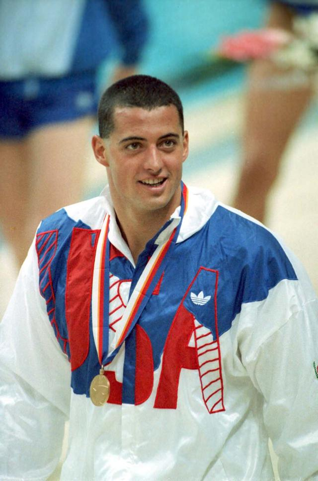 Matt Biondi of Moraga, Ca., U.S.A., is shown with his Olympic gold medal during awarding cermonies after the men's 800-meter freestyle relay at the Summer Olympic Games in Seoul, Korea, Sept. 21, 1988. Biondi anchored the U.S. team to a world record victory of 7 minutes, 12.51 seconds. (AP Photo/Eric Risberg)