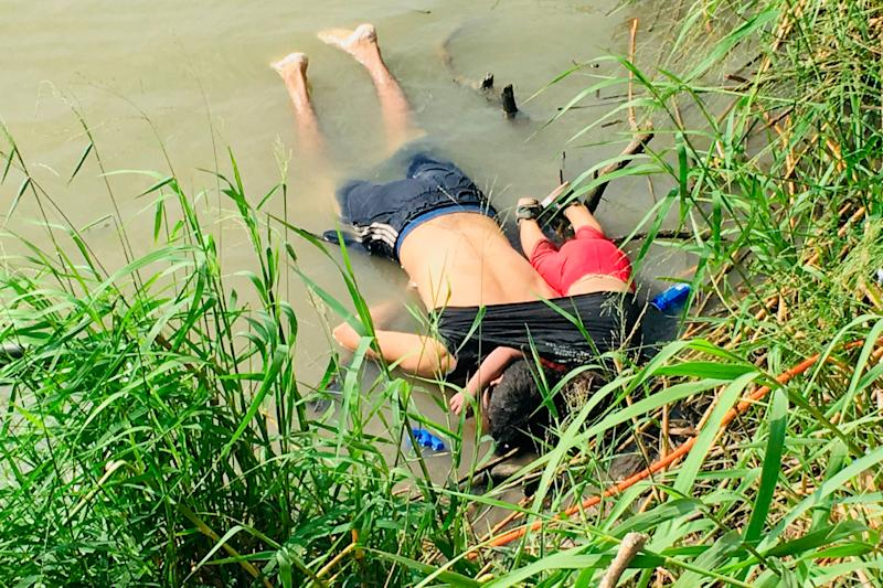 EDS NOTE: GRAPHIC CONTENT - The bodies of Salvadoran migrant Oscar Alberto Martínez Ramírez and his nearly 2-year-old daughter Valeria lie on the bank of the Rio Grande in Matamoros, Mexico, Monday, June 24, 2019, after they drowned trying to cross the river to Brownsville, Texas. Martinez' wife, Tania told Mexican authorities she watched her husband and child disappear in the strong current. (AP Photo/Julia Le Duc) ORG XMIT: MEX301