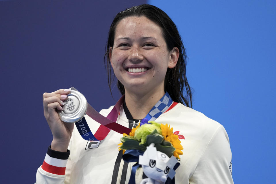 Siobhan Bernadette Haughey of Hong Kong holds up her silver medal fro the women's 200-meter freestyle final at the 2020 Summer Olympics, Wednesday, July 28, 2021, in Tokyo, Japan. (AP Photo/Matthias Schrader)