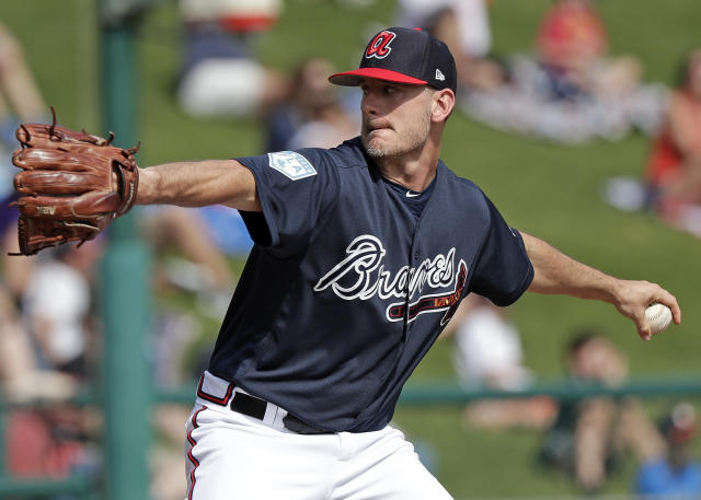 """FILE - In this March 4, 2019, file photo, Atlanta Braves' Grant Dayton pitches against the Houston Astros in the sixth inning of a spring baseball exhibition game in Kissimmee, Fla. Dayton is excited to driving north for the resumption of spring training with the Braves. He knows he will not be getting any more salary. """"It's going to be weird not getting a paycheck,"""" he said. Dayton is among 11 players who received $286,500 in advances that are higher than their prorated pay. (AP Photo/John Raoux, File)"""