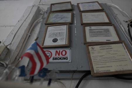 Government-issued licences and permits are seen at a bar in San Juan, Puerto Rico, November 4, 2016. REUTERS/Alvin Baez