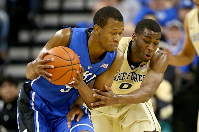 WINSTON-SALEM, NC - MARCH 05: Rodney Hood #5 of the Duke Blue Devils battles for a loose ball with Codi Miller-McIntyre #0 of the Wake Forest Demon Deacons during their game at Joel Coliseum on March 5, 2014 in Winston-Salem, North Carolina. (Photo by Streeter Lecka/Getty Images)