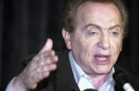 FILE - In this Wednesday, Aug 28, 2002, file photo, comic Jackie Mason addresses the media at Zanie's comedy club in Chicago about the club's decision to cancel comic Ray Hanania's appearance. Mason, a rabbi-turned-jokester whose feisty brand of standup comedy got laughs from nightclubs in the Catskills to West Coast talk shows and Broadway stages, has died. He was 93. Mason died Saturday, July 24, 2021, in Manhattan, the celebrity lawyer Raoul Felder told The Associated Press. (AP Photo/Stephen J. Carrera, File)