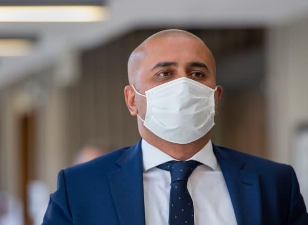Bassam Al-Rawi walks outside the courtroom during a break at Nova Scotia Supreme Court in Halifax in August 2020. (Andrew Vaughan/The Canadian Press - image credit)