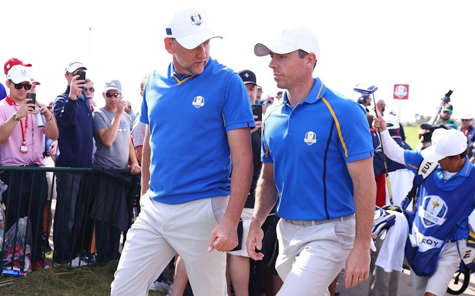 Ian Poulter and Rory McIlroy suffered a 5&3 defeat to USA rookies Xander Schauffele and Patrick Cantlay - GETTY IMAGES