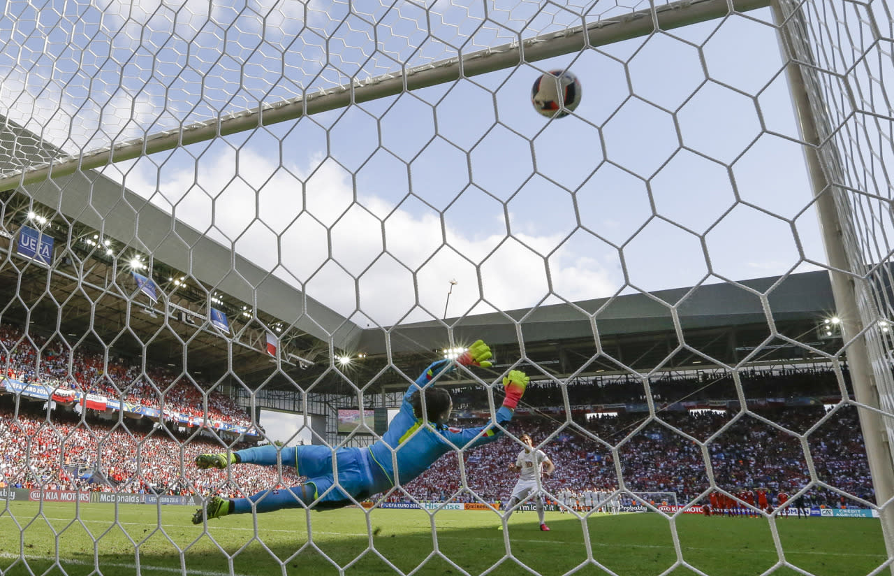 <p>Poland's Grzegorz Krychowiak scores the winning penalty past Switzerland goalkeeper Yann Sommer during a penalty shootout at the end of the Euro 2016 round of 16 soccer match between Switzerland and Poland, at the Geoffroy Guichard stadium in Saint-Etienne, France, Saturday, June 25, 2016. (AP Photo/Thanassis Stavrakis) </p>
