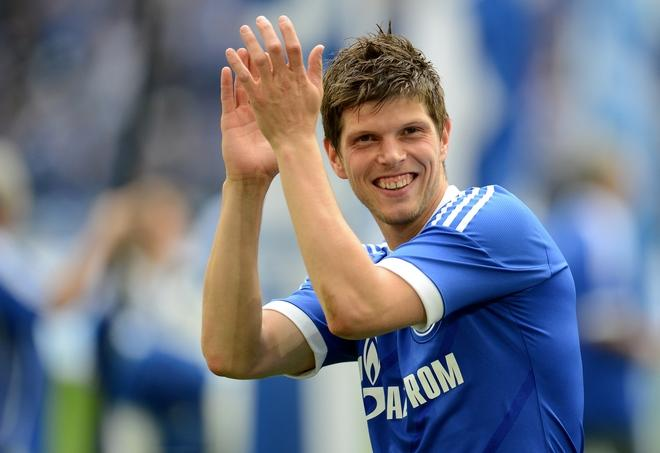 (FILES) A file picture taken on April 28, 2012 shows Schalke's Dutch striker Klaas-Jan Huntelaar thanking the fans after the German first division Bundesliga football match FC Schalke 04 vs Hertha BSC Berlin in Gelsenkirchen, western Germany. Nobody could accuse the Netherlands of being boring on the road to Poland and the Ukraine. Klaas-Jan Huntelaar topped the scoring charts in qualifying with 12 goals and he has also been in sensational form for club side Schalke, plundering 29 goals to win Kicker magazine's award for the Bundesliga's top marksman.  AFP PHOTO / PATRIK STOLLARZPATRIK STOLLARZ/AFP/GettyImages
