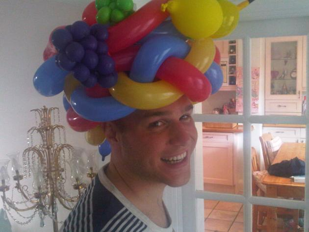"Celebrity photos: Olly Murs joked on Twitter this week that he'd ditched his trademark trilby hats for a new form of headgear, in the shape of a balloon hat. He posted this image along with the caption: ""Just bought a new hat for my summer shows ;)"""