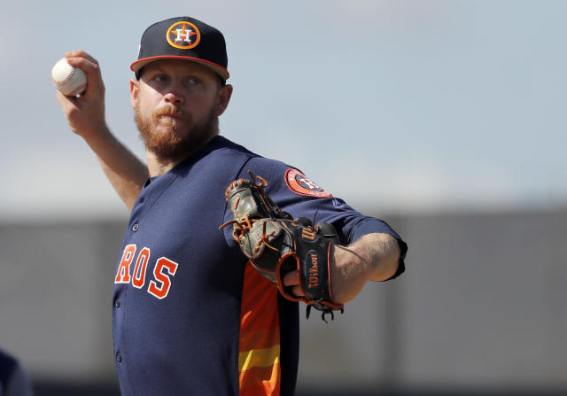 In this Feb. 15, 2018 file photo Houston Astros pitcher Chris Devenski throws to first during spring training baseball practice in West Palm Beach, Fla. Devenski and the Houston Astros avoided salary arbitration by agreeing to a one-year contract worth $1,525,000, Monday, Feb. 4, 2019. (AP Photo/Jeff Roberson, file)