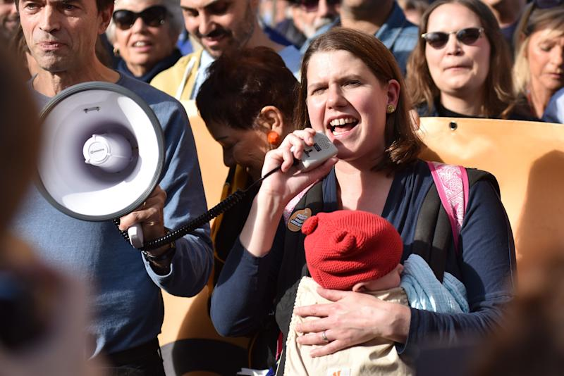 LONDON, ENGLAND - OCTOBER 20: Jo Swinson of the Liberal Democrats with baby Gabriel attends a march to demand a people's vote against Brexit on October 20, 2018 in London, England. Hundreds of thousands of people march from Park Lane to Parliament Square in what is said to be the largest public protest against Brexit so far. The march is to demand a People's Vote on the final Brexit deal amid growing support from MPs from all the main political parties for a final say referendum. (Photo by John Keeble/Getty Images)