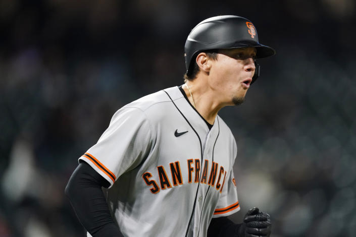San Francisco Giants' Wilmer Flores reacts as he heads up the first-base line after hitting a two-run home run in the sixth inning of game two of a baseball doubleheader Tuesday, May 4, 2021, in Denver. (AP Photo/David Zalubowski)