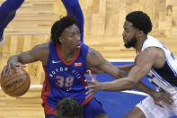 Detroit Pistons guard Saben Lee (38) sets up for a shot in front of Orlando Magic guard Chasson Randle (25) during the first half of an NBA basketball game, Tuesday, Feb. 23, 2021, in Orlando, Fla. (AP Photo/Phelan M. Ebenhack)