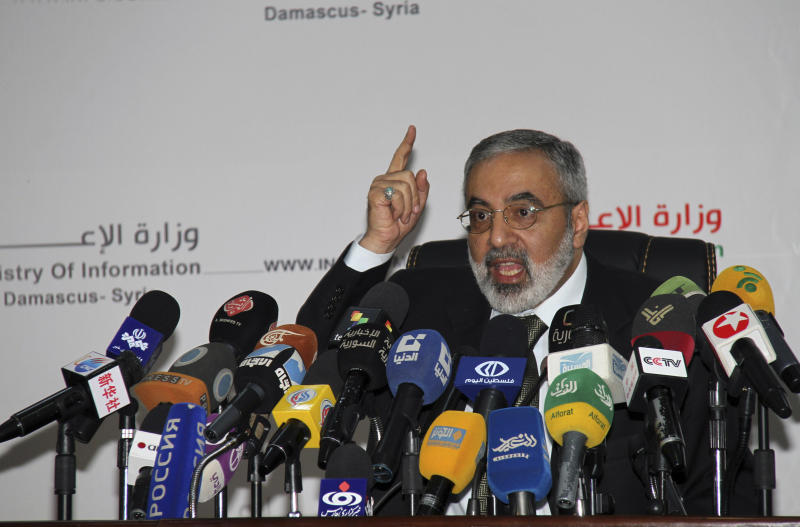 "Syrian Information Minister Omran al-Zoebi speaks during a press conference in Damascus, Syria, Monday, September 3, 2012. Al-Zoebi vowed that Syria will give the new U.N. envoy, Lakhdar Brahimi, ""maximum assistance the way we did with Kofi Annan."" The Assad regime made similar public statements when it signed on to Annan's peace plan, only to frequently ignore or outright violate its commitments, by failing to pull its troops out of cities or stop shelling opposition areas. (AP Photo Bassem Tellawi)"
