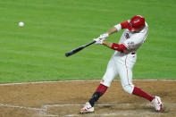 Cincinnati Reds first baseman Joey Votto (19) hit a game-winning RBI double during the tenth inning of a baseball game against the Kansas City Royals at Great American Ballpark in Cincinnati, Tuesday, Aug. 11, 2020. (AP Photo/Bryan Woolston)