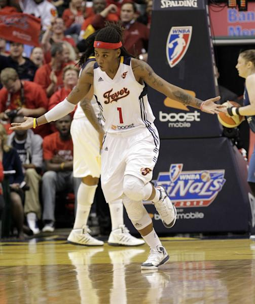 Indiana Fever guard Shavonte Zellous celebrates after making a basket against the Minnesota Lynx in the second half of Game 3 of the WNBA basketball Finals, Friday, Oct. 19, 2012, in Indianapolis. The Fever won 76-59. (AP Photo/AJ Mast)