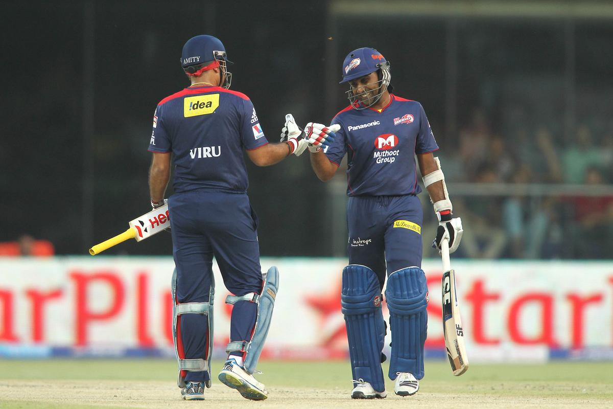 Virender Sehwag of Delhi Daredevils and Delhi Daredevils captain Mahela Jayawardene celebrate a boundary during match 28 of the Pepsi Indian Premier League between The Delhi Daredevils and the Mumbai Indians held at the Feroz Shah Kotla Stadium, Delhi on the 21st April 2013. (BCCI)