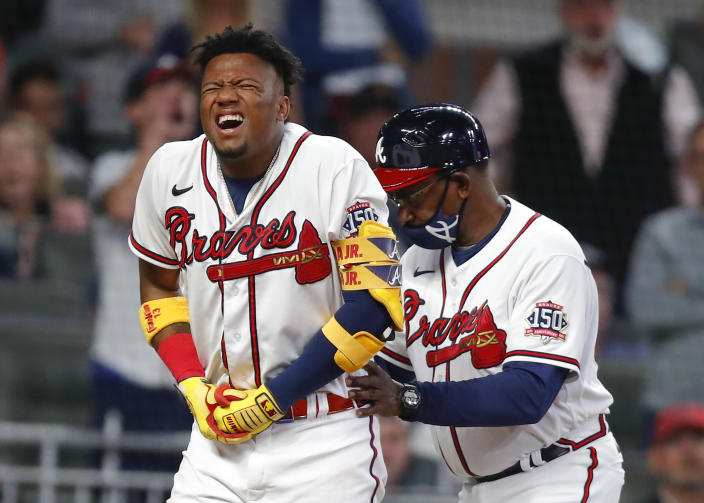Ronald Acuna Jr. of the Atlanta Braves reacts after being hit by a pitch