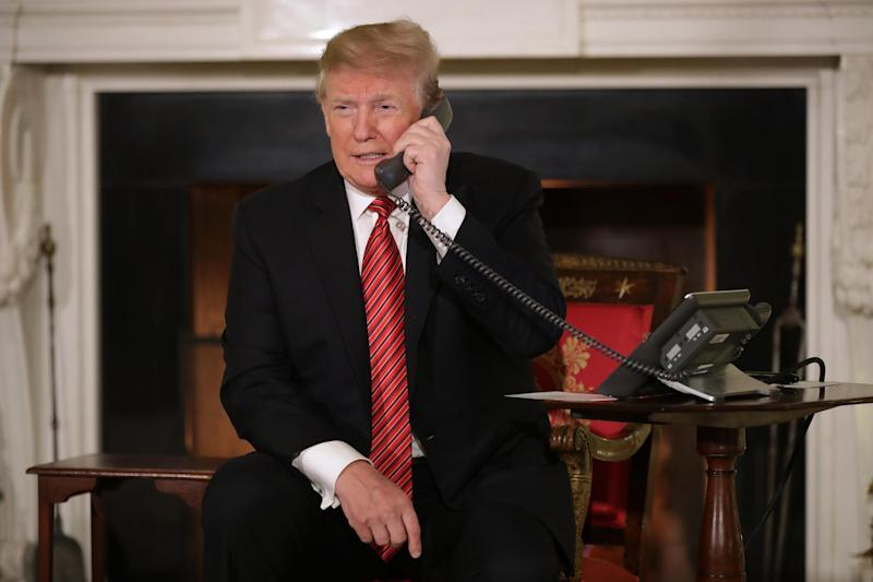 A file photo of Donald Trump taking calls on Christmas Eve in 2018 at the White House: Getty Images