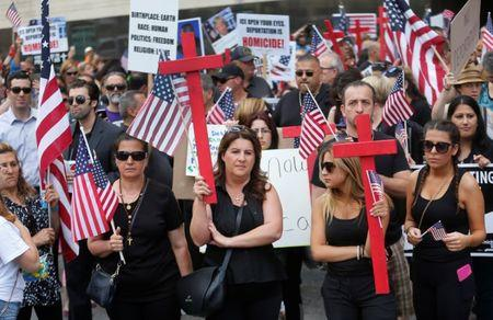 FILE PHOTO: Protesters rally outside the federal court just before a hearing to consider a class-action lawsuit filed on behalf of Iraqi nationals facing deportation, in Detroit, Michigan, U.S., June 21, 2017.   REUTERS/Rebecca Cook