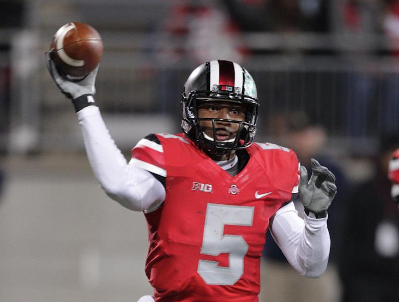 Ohio State quarterback Braxton Miller drops back to pass against Penn State during the first quarter of an NCAA college football game Saturday, Oct. 26, 2013, in Columbus, Ohio. (AP Photo/Jay LaPrete)