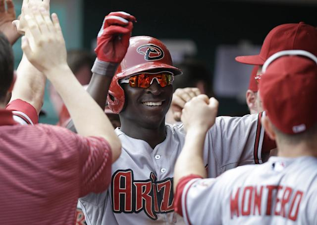 Arizona Diamondbacks' Didi Gregorius is congratulated in the dugout after hitting a two-run home run off Cincinnati Reds relief pitcher Carlos Contreras in the ninth inning of a baseball game, Wednesday, July 30, 2014, in Cincinnati. Arizona won 5-4. (AP Photo/Al Behrman)