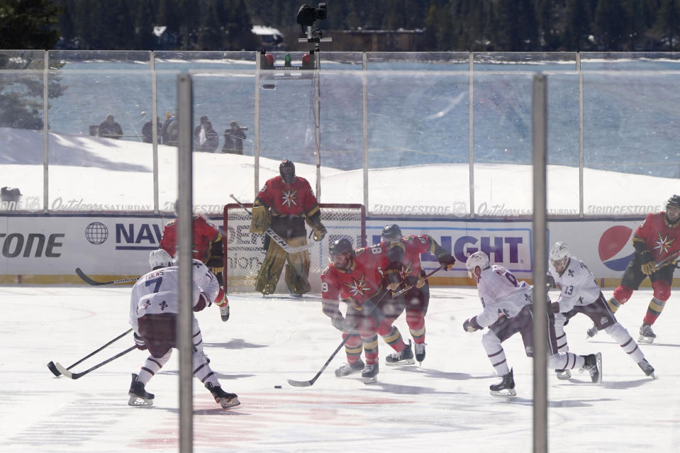 Vegas Golden Knights right wing Alex Tuch (89) races for the puck against the Colorado Avalanche during the first period of of Outdoor Lake Tahoe NHL hockey game at Stateline, Nev., Saturday, Feb. 20, 2021. (AP Photo/Rich Pedroncelli))