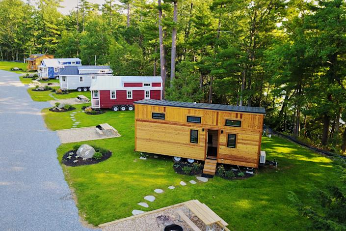 Tuxbury Pond's largest tiny home, Emerson (right), can sleep up to six people.