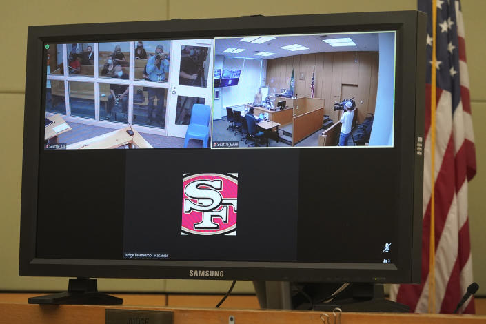 A logo for the San Francisco 49ers NFL football team is shown on the video link window of King County District Court Judge Fa'amomoi Masaniai at the bottom of a video monitor, Thursday, July 15, 2021, before the start of a hearing for NFL football cornerback Richard Sherman in a court room at the King County Correctional Facility in Seattle. Sherman, who has played for 49ers and the Seattle Seahawks, was arrested early Wednesday after police said he crashed his car in a construction zone and then tried to break into his in-laws' home in the Seattle suburb of Redmond, Wash. (AP Photo/Ted S. Warren)