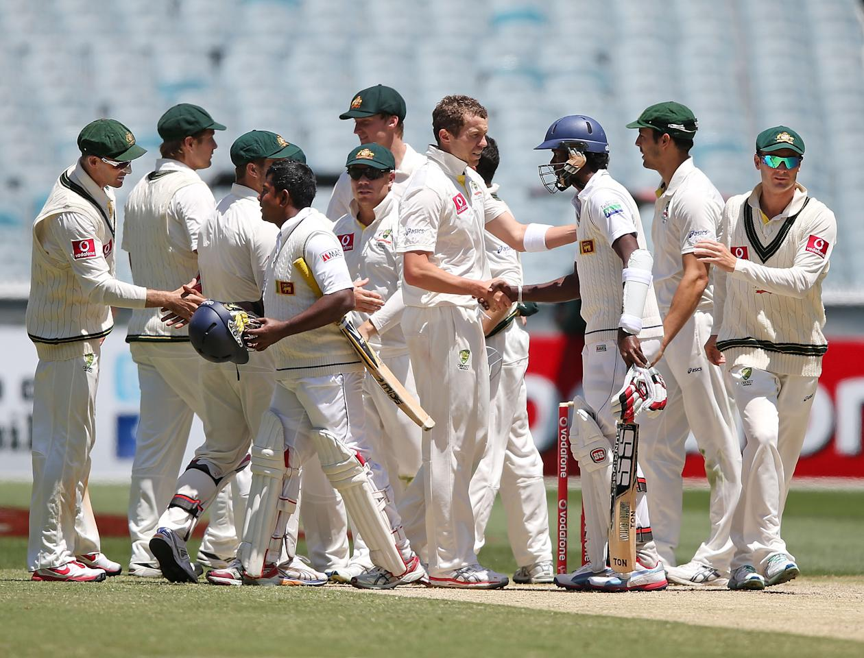 MELBOURNE, AUSTRALIA - DECEMBER 28:  The Sri Lankan batsmen congratulate the Australian cricket team who won the match during day three of the Second Test match between Australia and Sri Lanka at Melbourne Cricket Ground on December 28, 2012 in Melbourne, Australia.  (Photo by Michael Dodge/Getty Images)