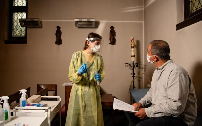 A patient is tested at The Sint Rochus Catholic Church in Deurne which has been transformed into a covid-19 testing center for the people of Antwerp - Jean-Christophe Guillaume/Getty Images Europe