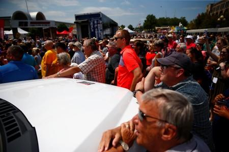 People listen as Democratic 2020 U.S. presidential candidate and former U.S. Vice President Joe Biden speaks at the Iowa State Fair in Des Moines