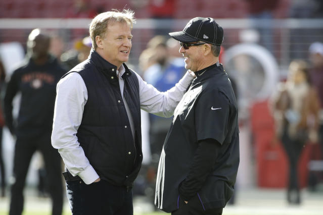 NFL Football Commissioner Roger Goodell, left, talks with Minnesota Vikings head coach Mike Zimmer before an NFL divisional playoff football game between the San Francisco 49ers and the Vikings, Saturday, Jan. 11, 2020, in Santa Clara, Calif. (AP Photo/Marcio Jose Sanchez)