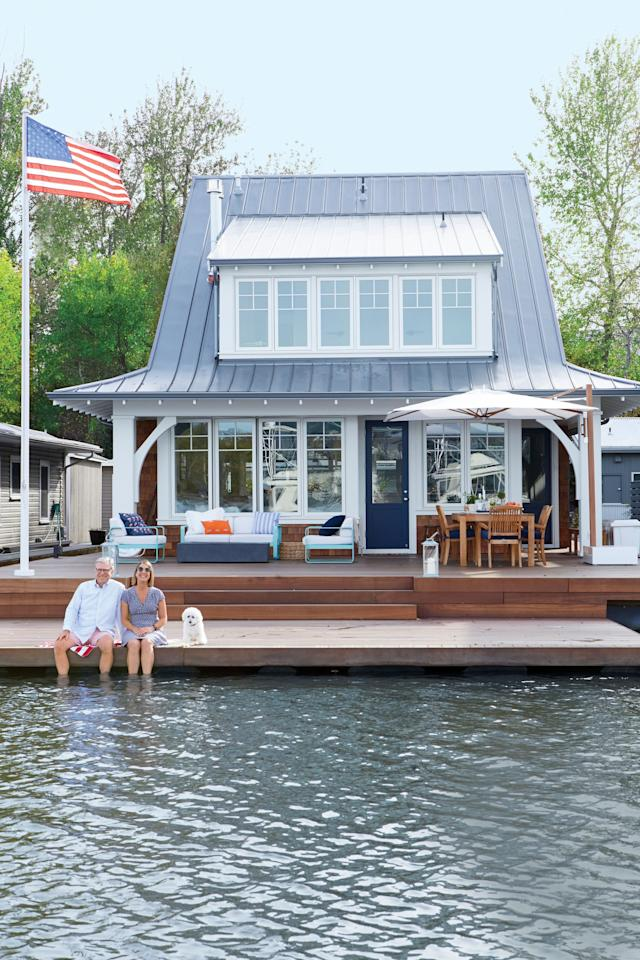 """<p>Not many people can say they live on the water and mean it literally. But Bill and LauraLee Symes can, thanks to their shingle-style cottage that shares an address with fish, bald eagles, and otters on the Willamette River in Portland, Oregon. It's part of a small floating-home community called the <a href=""""http://www.oregonyachtclub.com/"""">Oregon Yacht Club</a>, which dates to 1900 and was originally a traditional yacht club with a clubhouse, sailboat races, and swimming events.</p> <p>""""We're both big sailors and had always thought it looked like an interesting place to live,"""" says Bill. """"But I think it was my wife's persistence that eventually sold us. She managed the <a href=""""http://willamettesailingclub.com/"""">Willamette Sailing Club</a> across the river and would see these beautiful new homes being tugged to the community, so she just fell in love."""" Here, more on why they traded in their sprawling terrestrial home for a compact floating paradise.</p> <p><strong>Pictured:</strong> The two-story floating home sits in a slip along the Willamette River, with a red balau deck that doubles as a boat launch for kayaks and paddleboards.</p>"""