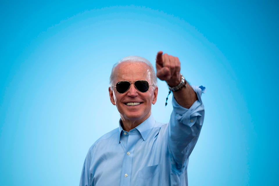 <p>Biden points to the crowd in his iconic aviators</p> (AFP via Getty Images)