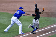 Toronto Blue Jays first baseman Rowdy Tellez, left, tags Baltimore Orioles' Rio Ruiz after fielding a groundout during the sixth inning of a baseball game in Buffalo, N.Y., Sunday, Aug. 30, 2020. (AP Photo/Adrian Kraus)
