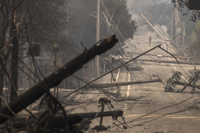 <p>Power poles and lines block a street at Brookdale and Aaron Dr. in Hidden Valley where most of the homes were destroyed by fire on Oct. 9, 2017 in Santa Rosa, Calif. (Photo: Brian van der Brug/Los Angeles Times via Getty Images) </p>